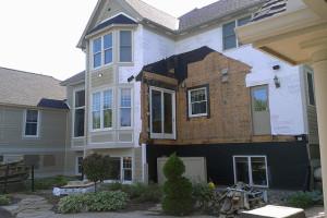 Demolition Stucco/New Siding